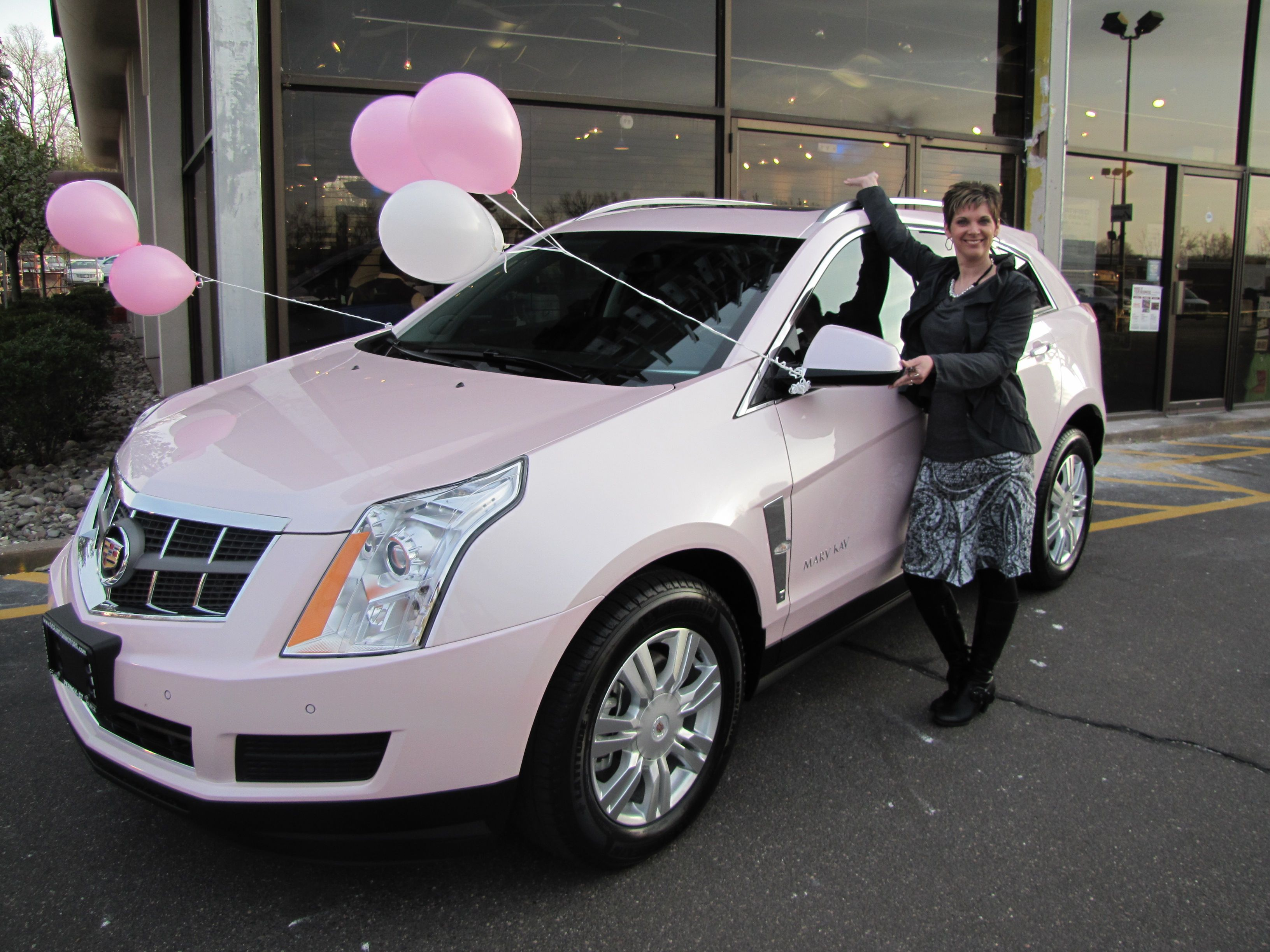 Pink Cadillac SRX <3 this is my dream car, but justin would
