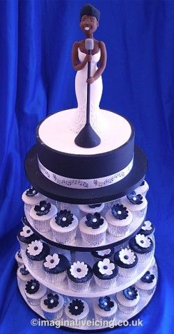 Jazz Blues Singer Birthday Cake with Black White Cupcakes Food