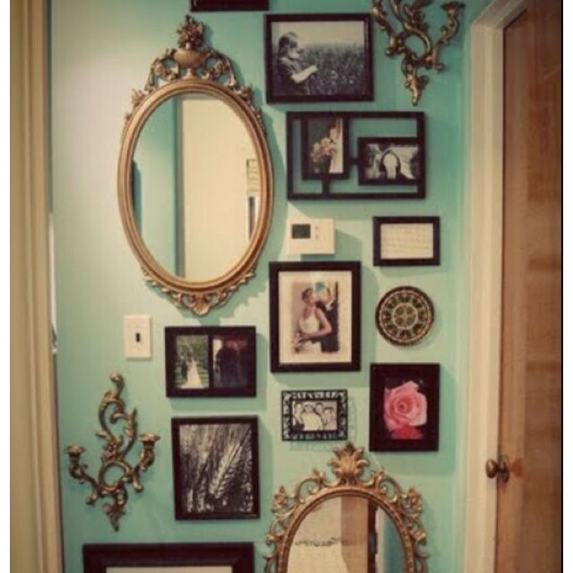 LIke the mixed frames with vintage . . . I would have put a frame ...