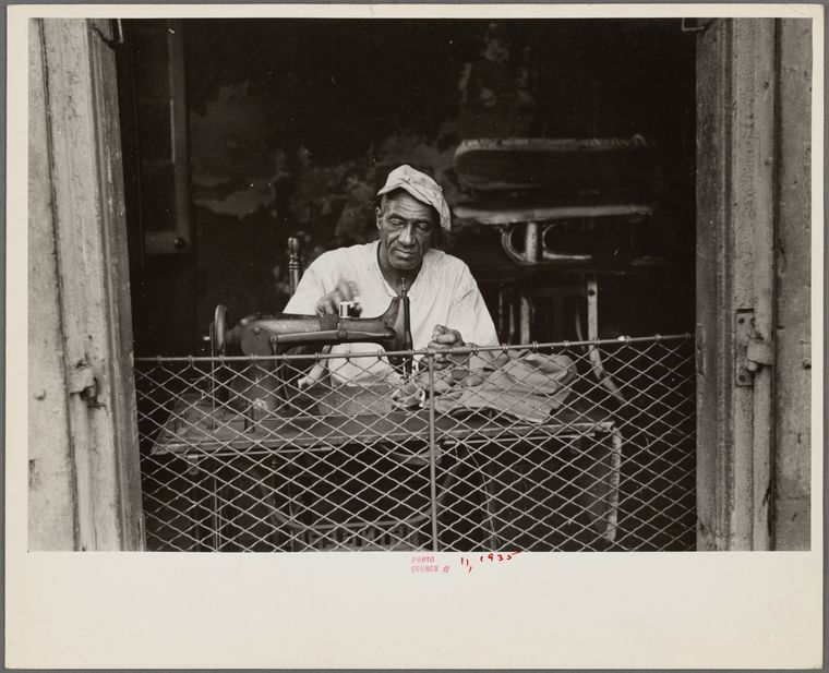 1935 Scene in New Orleans, Louisiana. A street tailor | New