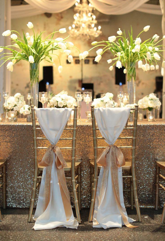#chair-sash, #chair-decor, #centerpiece Photography: Landon Jacob Productions - landonjacob.com Read More: http://www.stylemepretty.com/2014/10/16/sparkling-sequin-winter-wedding-in-columbia-sc/