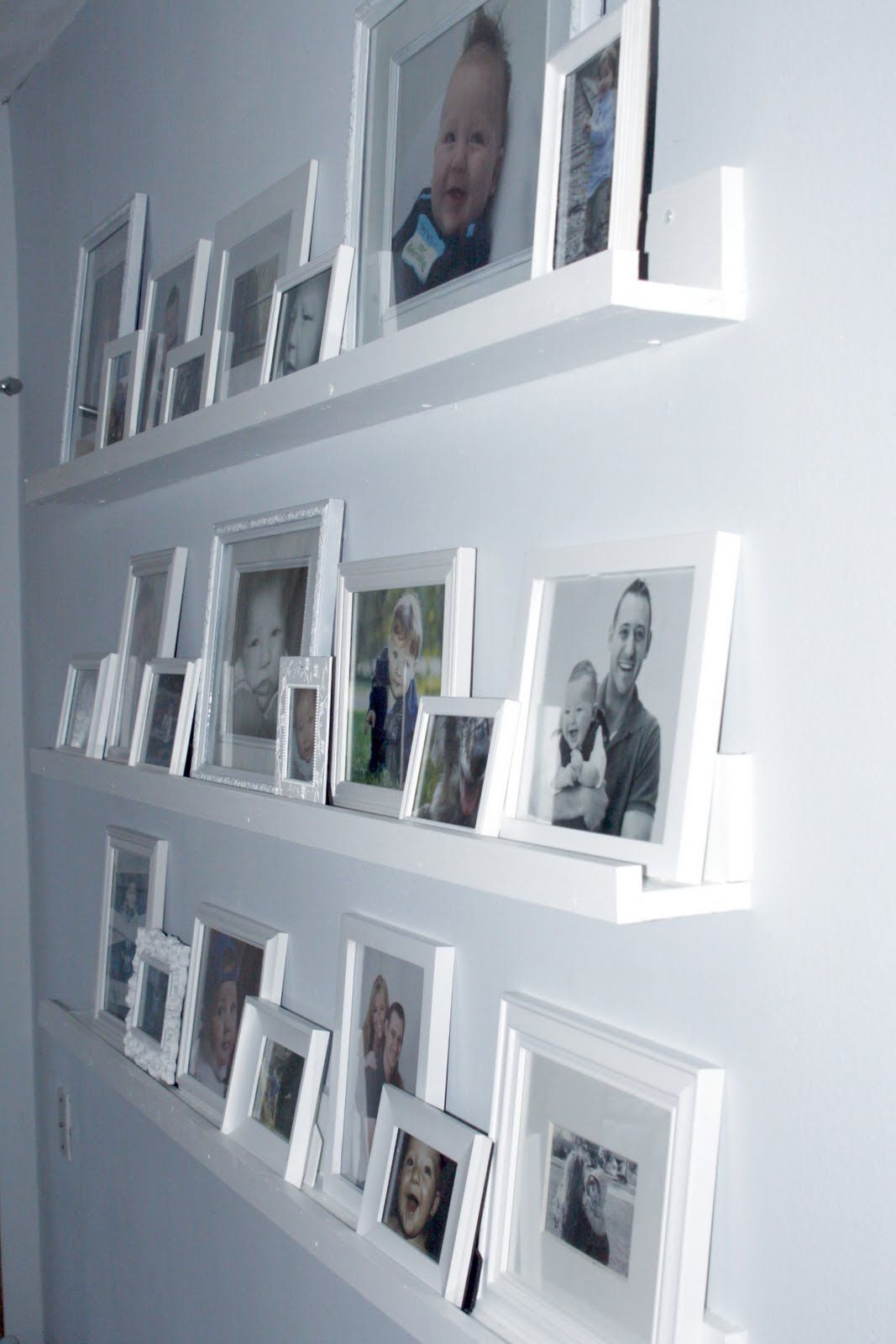 Framed Photos On Shelves Rather Than Hanging On Nails In The Wall