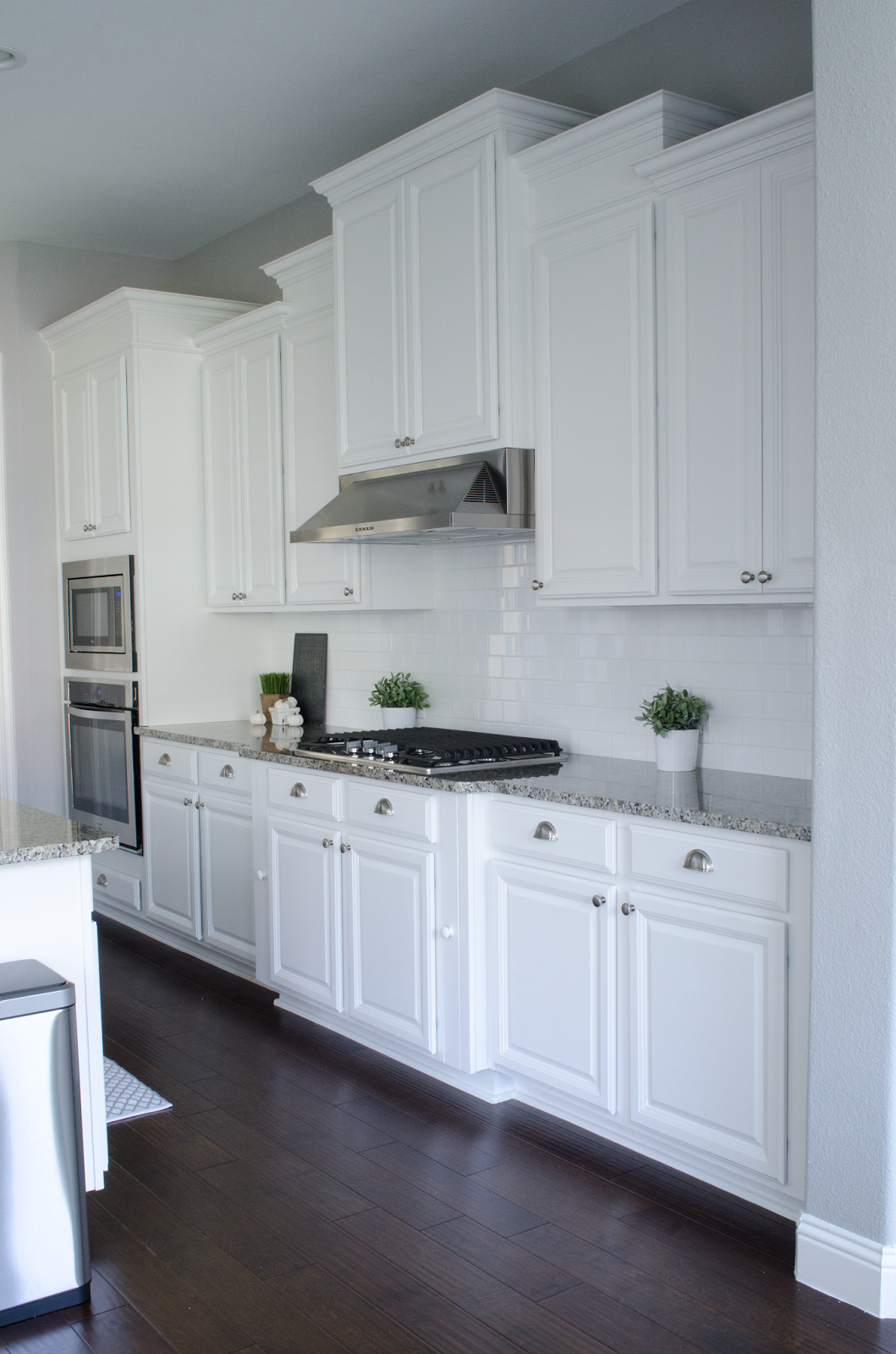 Uneven Kitchen Floor Creamy White Cabinets Paired With Supreme White Quartzite