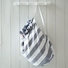 Striped Laundry Room Hamper, they had a blue one with nautical anchors on it at the store, but I can't find it online | west elm