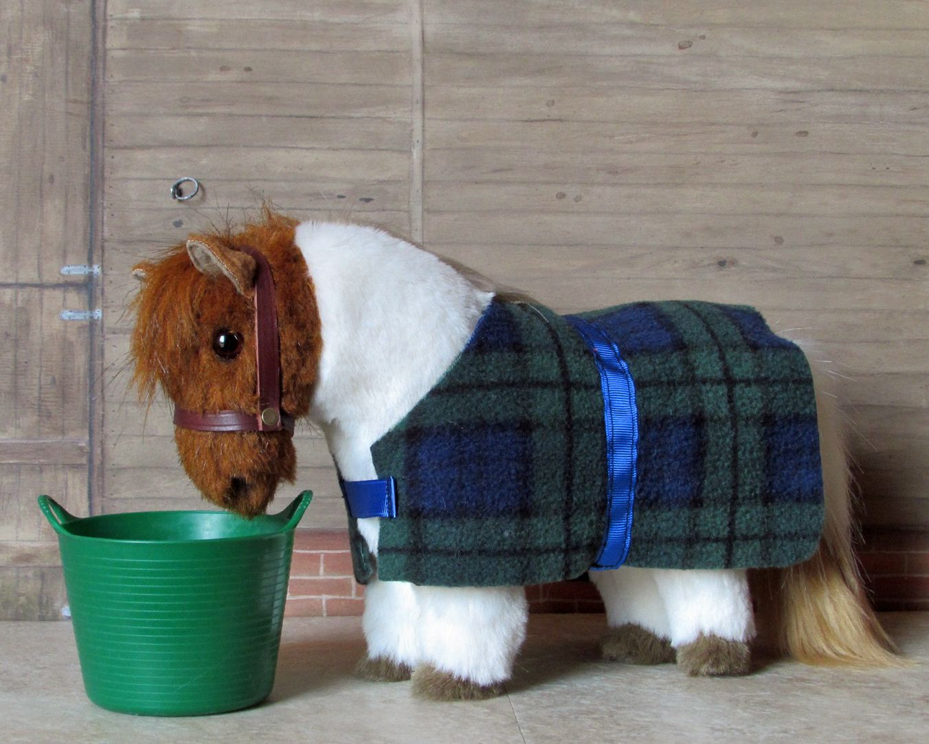 Pippin A Skewbald Shetland Pony With Checked Fleece Rug