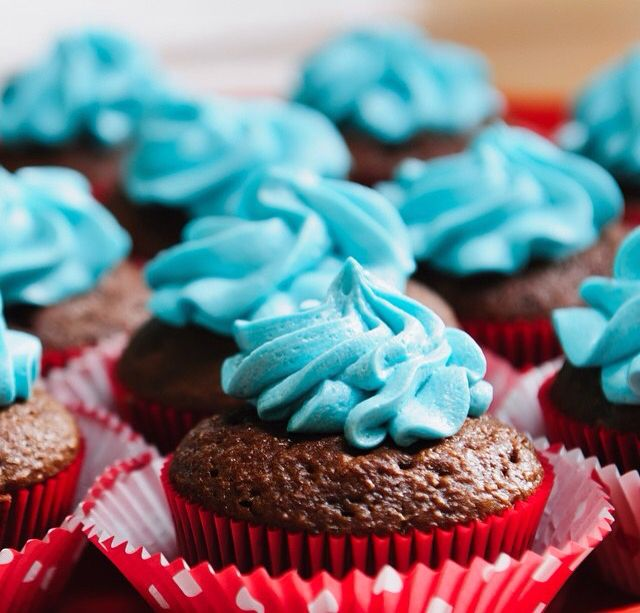 Chocolate cupcakes and blueberry frosting.