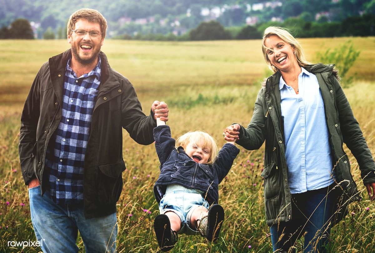 Download premium photo of family parents holding hands boy