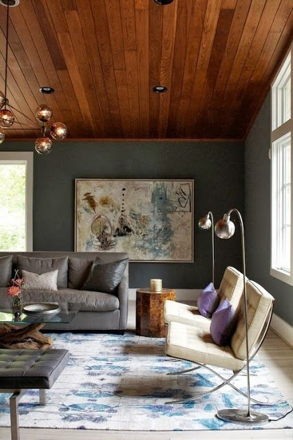 Richness Of Earth Tones. Deep Warm Wood Planked Ceiling And Muted Moss  Green Walls