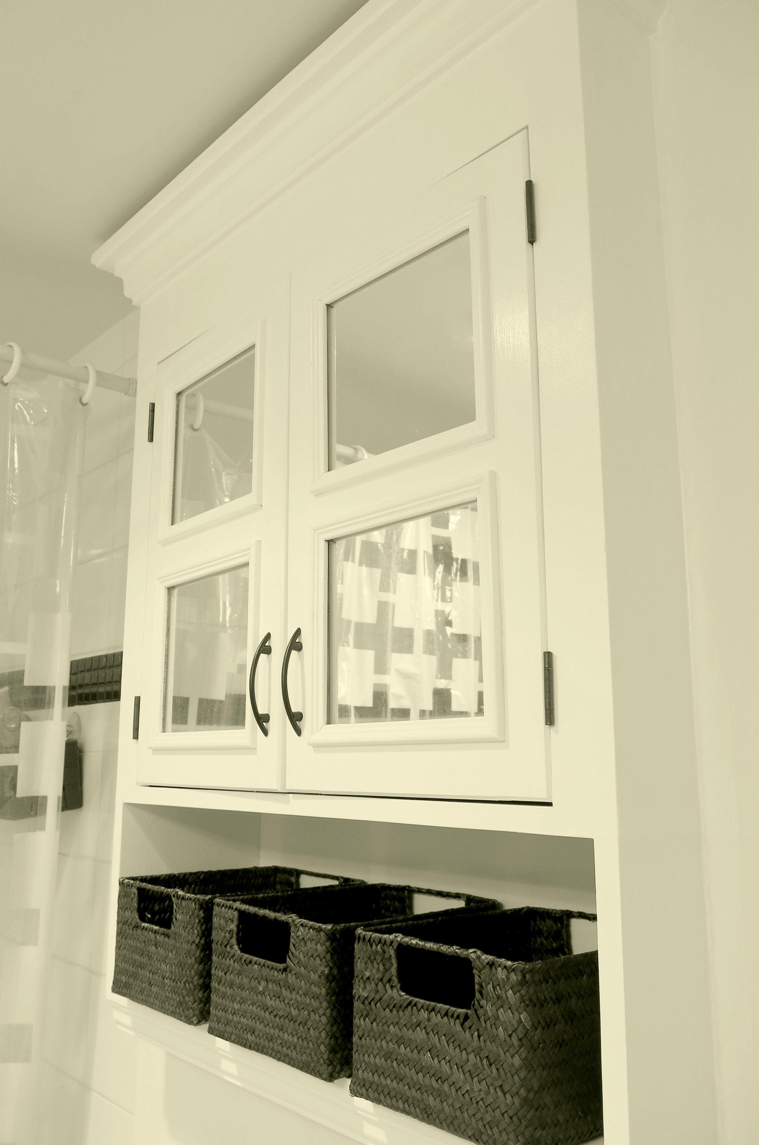 bathroom medicine cabinet/storage cupboard with basket organizers, mirror panels, crown molding, white wood