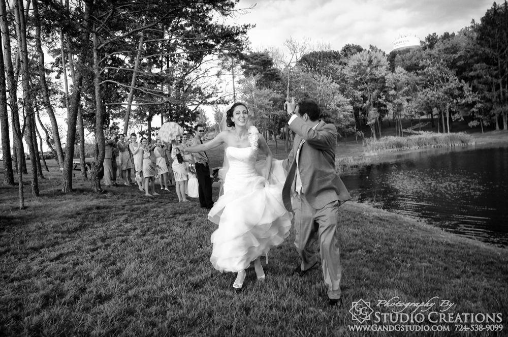 Running bride and groom
