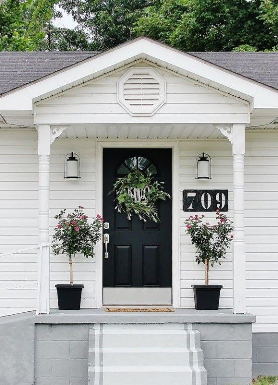 White porch, stained concrete & black door | Our Fixer Upper ...