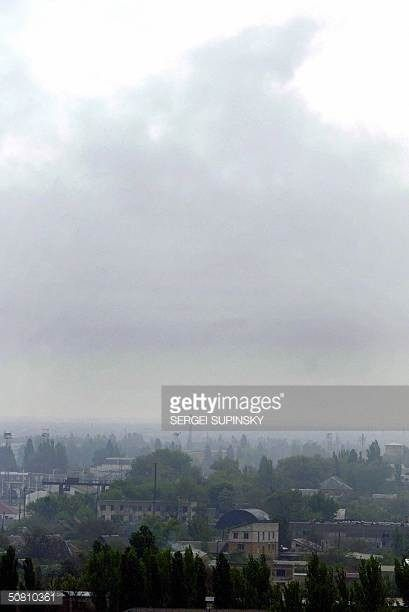 06-16 MELITOPOL, UKRAINE: Smoke billows above Melitopol, a small... #melitopol: 06-16 MELITOPOL, UKRAINE: Smoke billows above… #melitopol