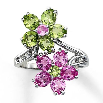 Two flowers decorated with peridot and lab-created pink sapphires create a dramatic effect in this sterling silver ring for her.