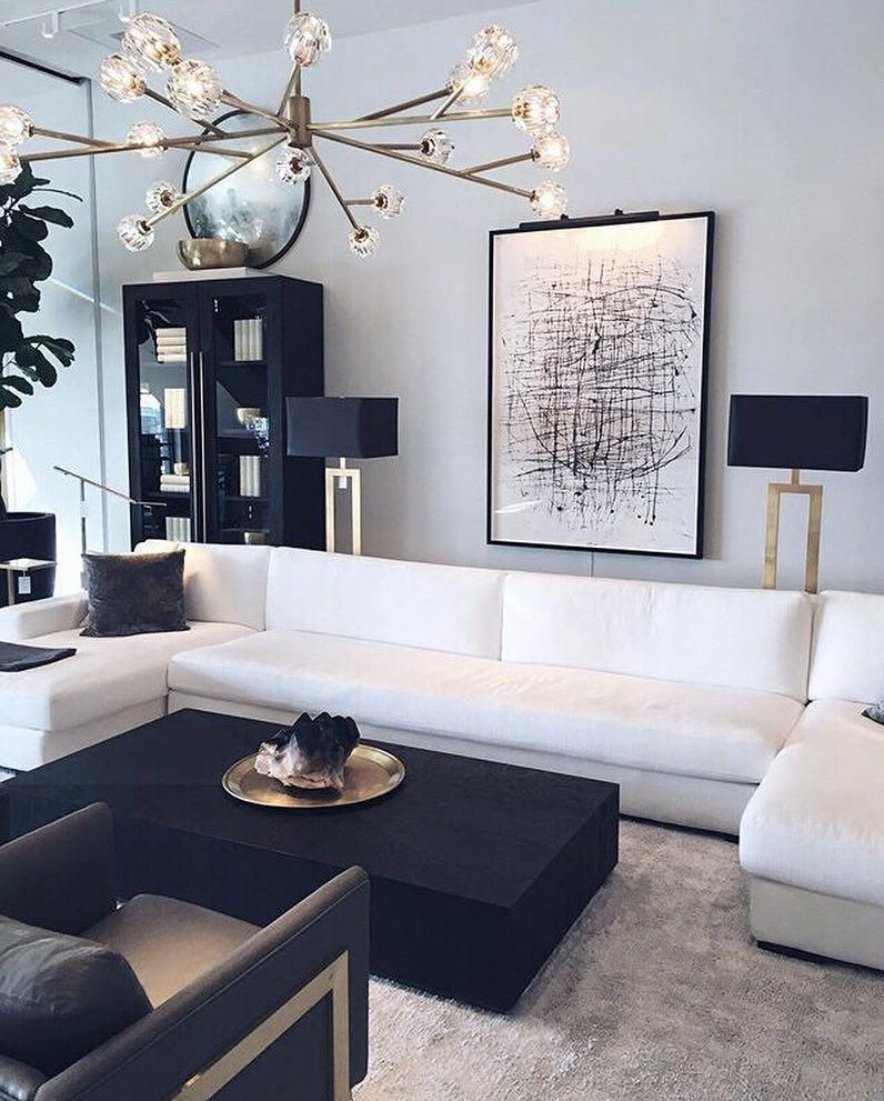 Oil Blue Discover 60 Decorating Ideas That Use Color With Images Black And White Living Room Decor White Living Room Decor Black Living Room Showroom living room ideas