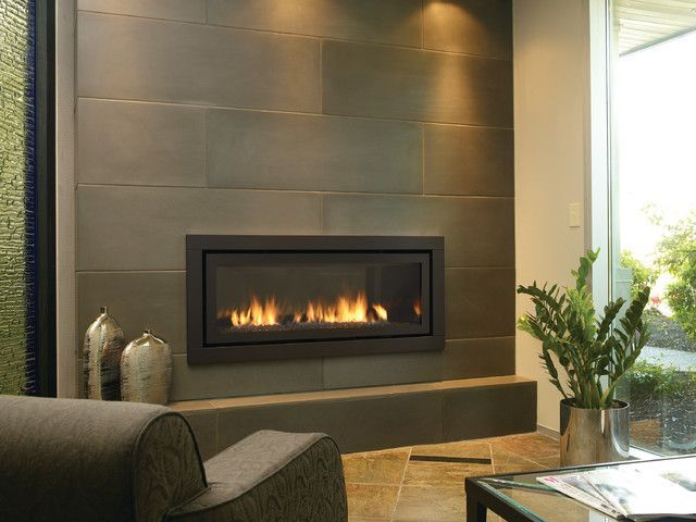 Modern Brick Fireplace; porcelain tile clad, solid surface slab on ...