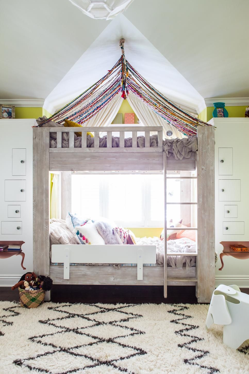 Whimsical Kids Room Features Bunk Beds With Hand Knotted Yarn