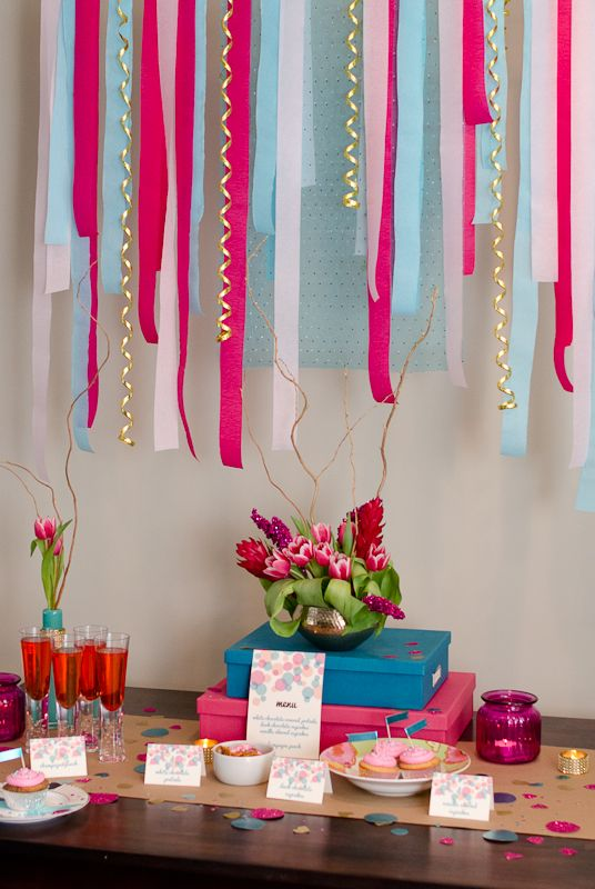 07fac88dd22 This bridal shower idea used crepe papers as its backdrop. Hot pink and  turquoise are beautiful bridal shower color combination