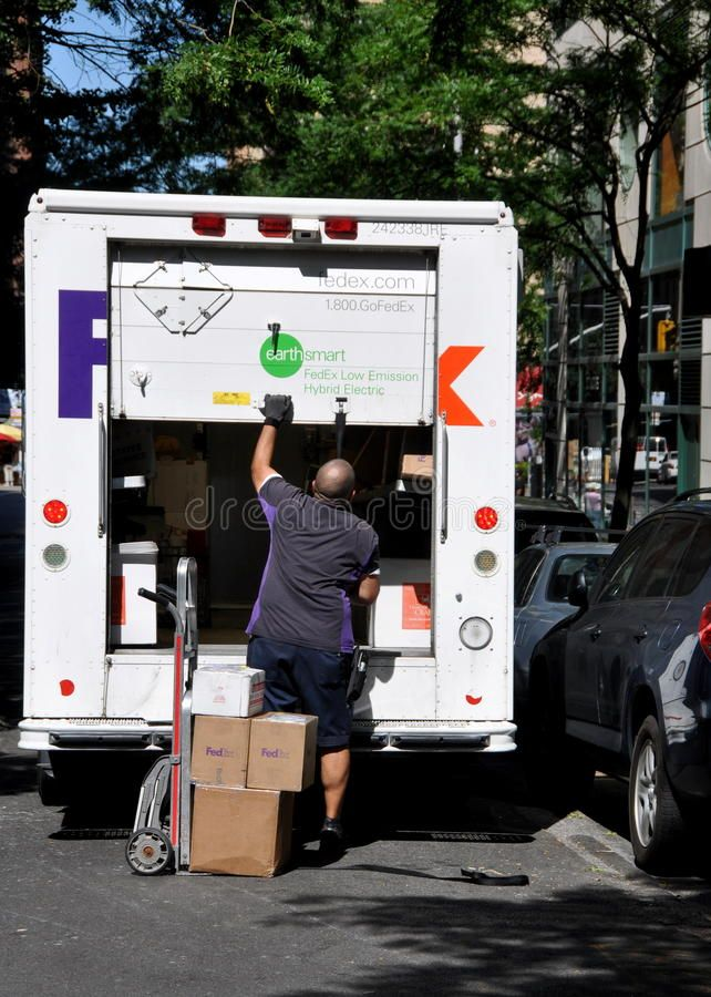NYC FEDEX Delivery Man and Truck. A FEDEX delivery man
