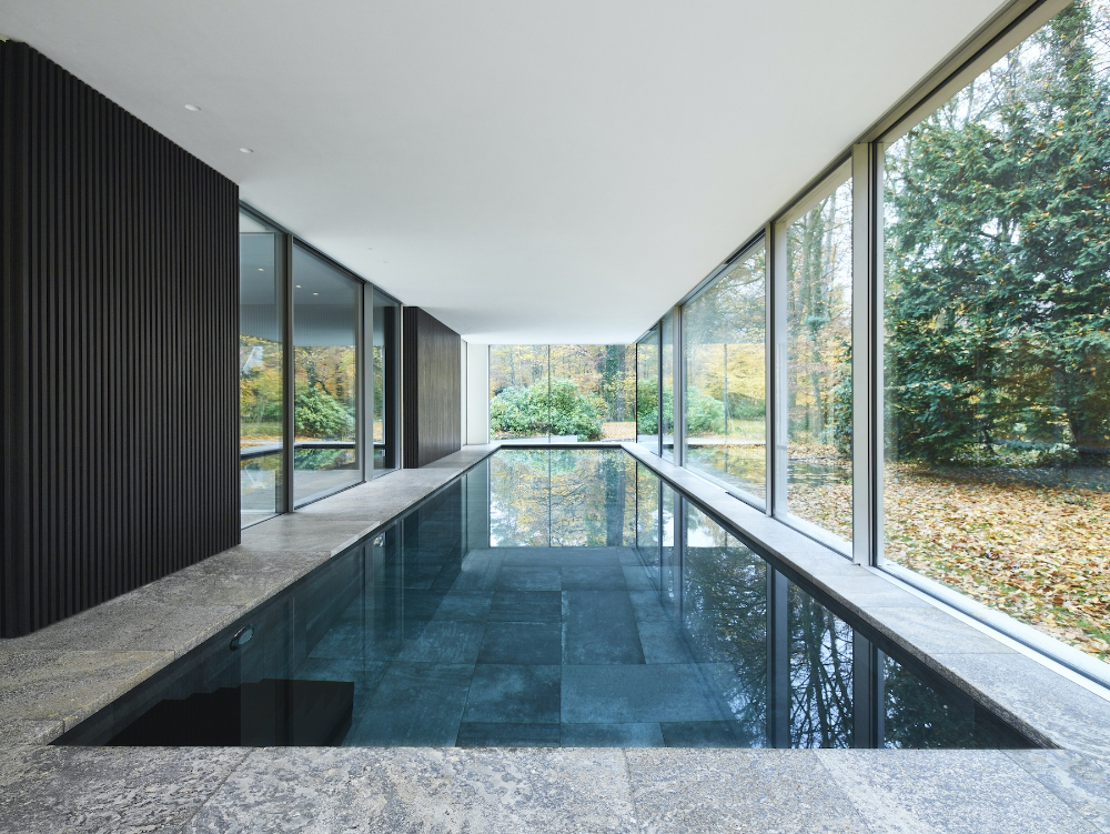 Photo of In Antwerp, This Family Home Blends Seamlessly Into Its Woodland Setting – IGNANT