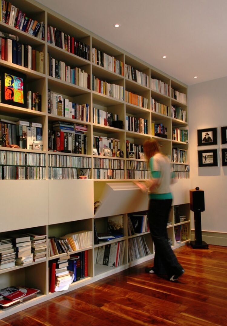 Floor To Ceiling White Bookshelves And Floorboards Floor To