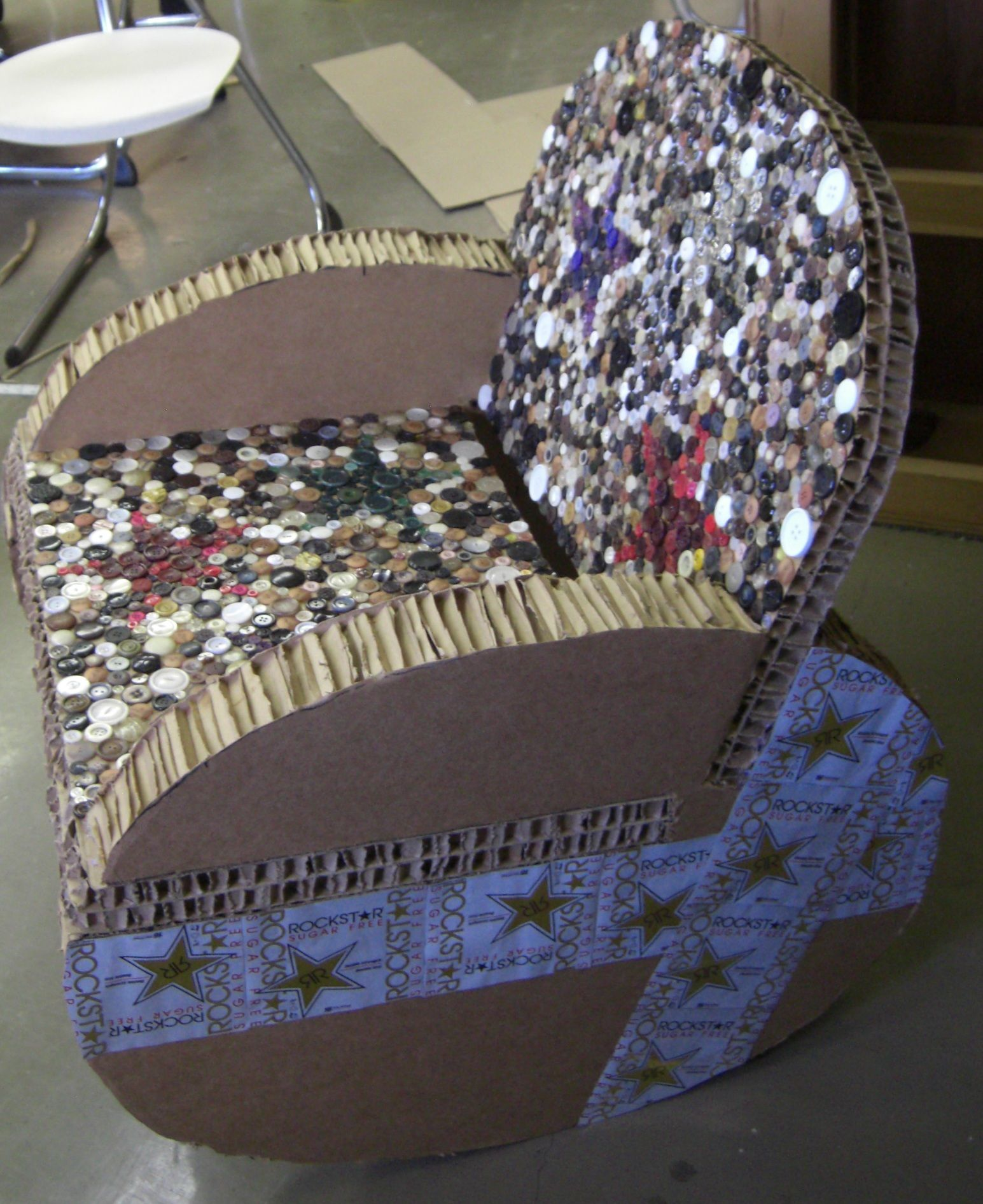 Cardboard rocking chair - Cardboard Rocking Chair With 1800 Individually Placed Buttons For Upholstery Created For A Competition