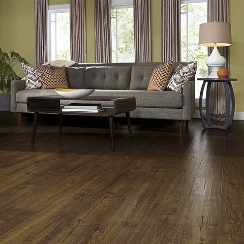 Auburn Scraped Oak Natural Laminate Floor With Wear And Spill