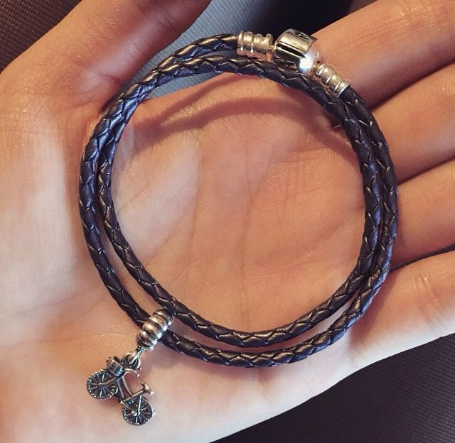 Black pandora bracelet with bike charm