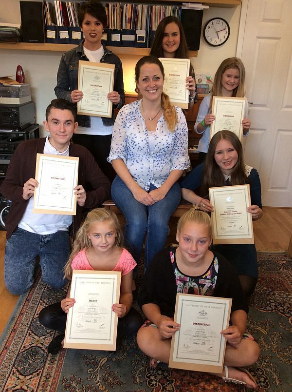 Lucy Lockwood (centre, seated) with some of the successful students
