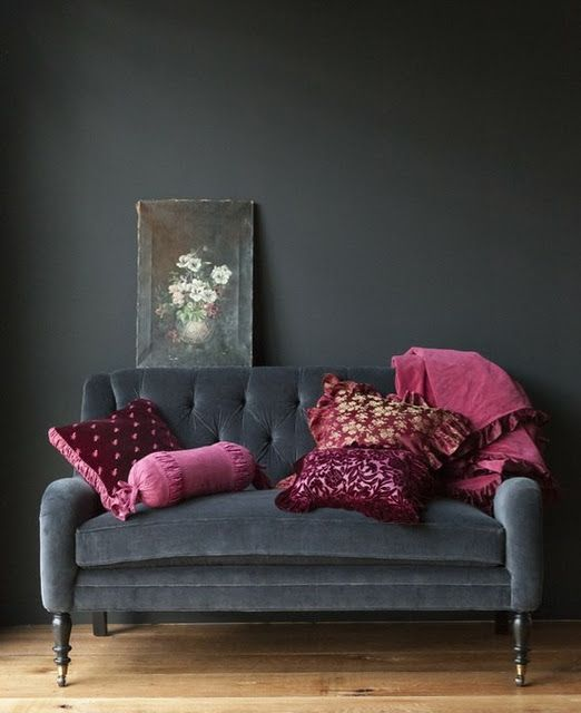 I love the dark greys with just a splash of color - add white painted floors and some seashells and viola.