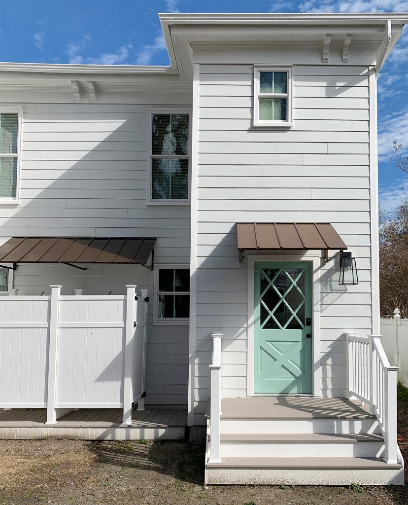 Before After Of The Back Of The Duplex Young House Love Garage Door Design Porch Makeover Metal Awning