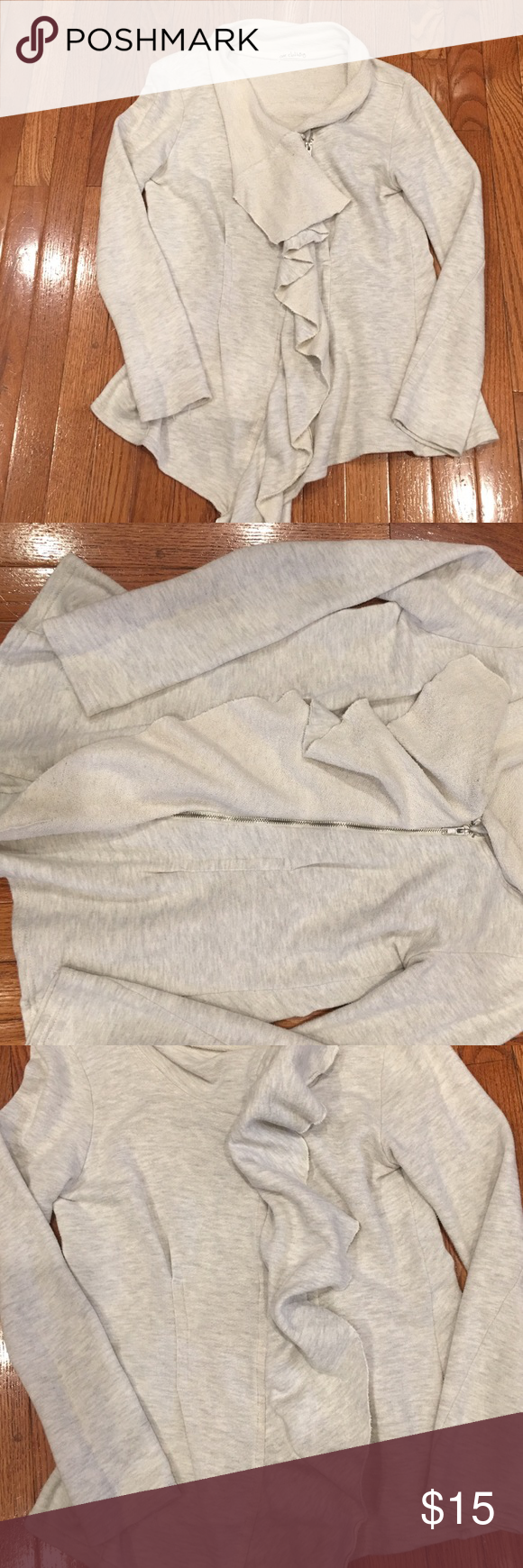 Sweatshirt jacket Lightweight sweatshirt material jacket. Ruffled front with silver zipper. Gathered in the back. Shown in picture #4. Gently used without stains or tears. Jackets & Coats