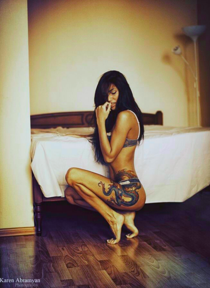 Naked girl tattoo on side