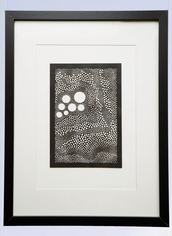 Hand cut circles, holes punched by hand using a Japanese Screw Punch