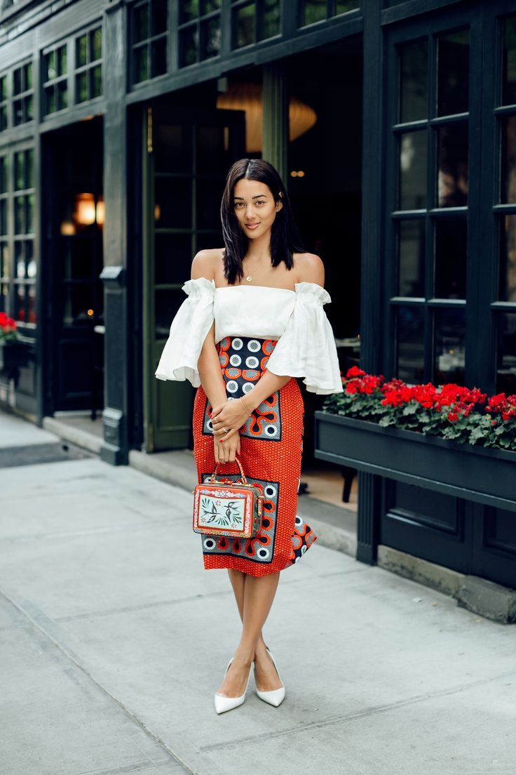 fashion blogger wearing statement skirt and white top, street style, avant garde, ootd, outfit ideas, style blog, orange skirt