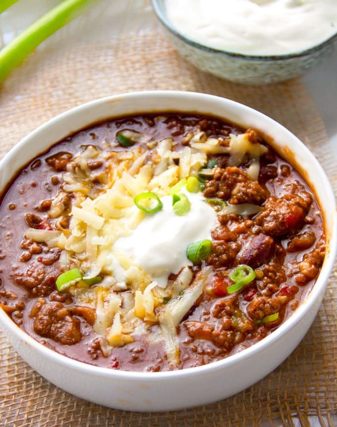 This award winning chili is the absolute best, with a robust meaty flavor, the perfect amount of heat, beef, pork, beans, fresh chile peppers, awesome spices, onions, garlic, tomatoes and beer. (freezes well too) Everyone needs a great chili con carne recipe in their repertoire! #chili #chilirecipe #chiliconcarne