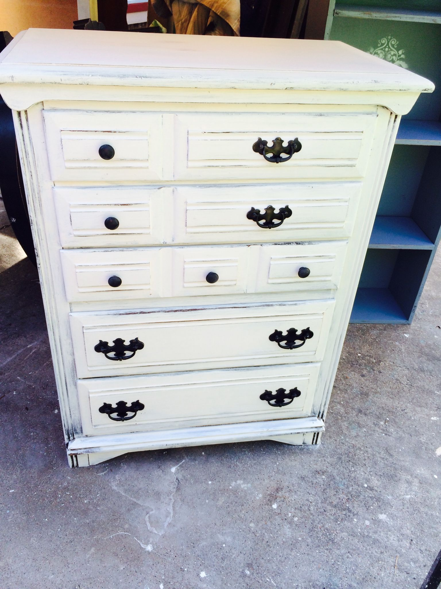 This is a white washed shabby chic chest of drawers that is that I