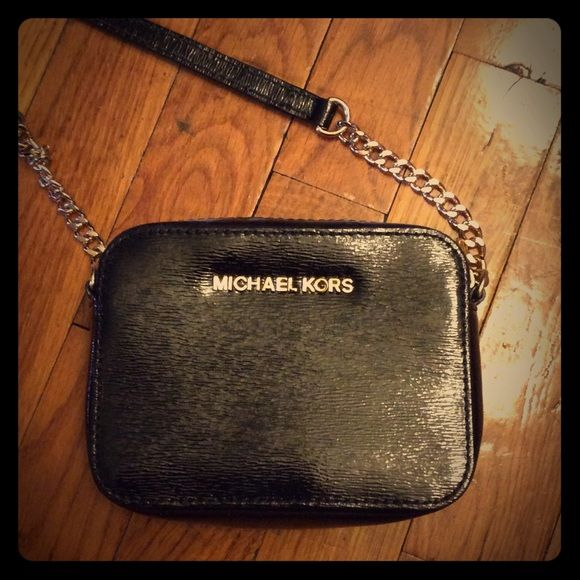 91885f17688e Michael Kors cross body Cute cross body mini bag awesome for nights out!  Black patent leather with gold chain and strap, and gold Michael Kors  emblem. used ...