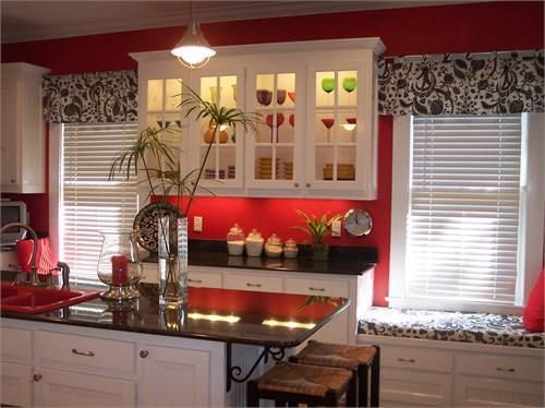 i love white cabinets with black counter tops AND THEN add a red wall  behind it