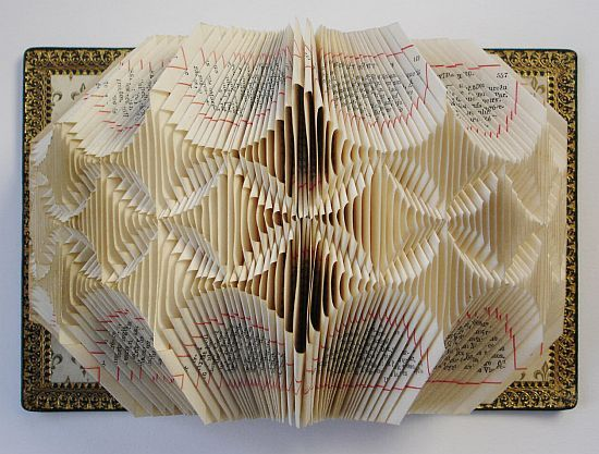 Folded books, by Lucille Moroni