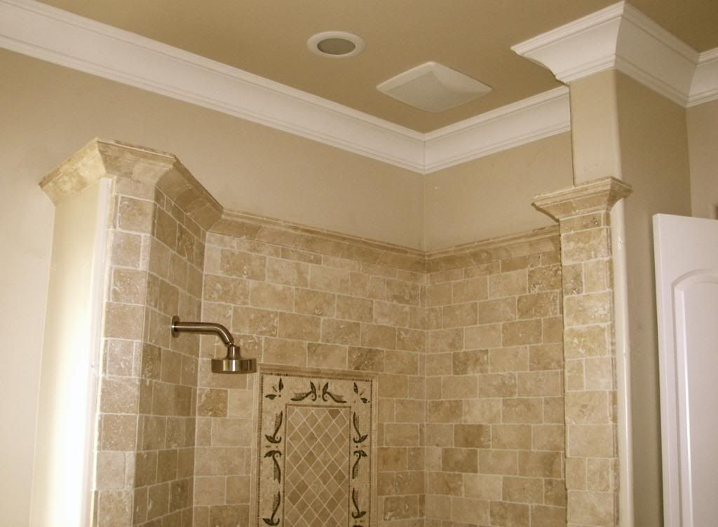 This ornate shower features travertine crown molding capped with ...