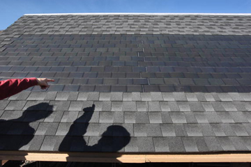 Solar Panels Attached To Roof Shingles Create Energy While Being Tested At The National Renewable Energy Laboratory Nrel In 2020 Solar Roof Solar Shingles Solar Tiles