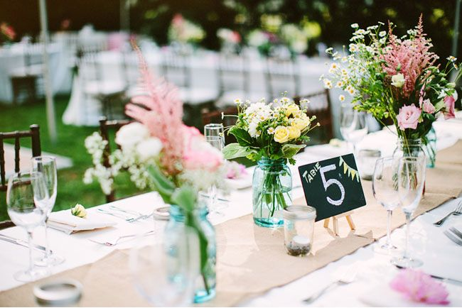 chalkboard easel table numbers and another way to dress up a basic white table cloth that still looks rustic--with kraft paper.
