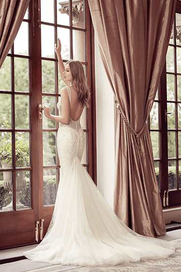 ee5712994b35 We love this backless lace fishtail wedding dress by Ronald Joyce ...