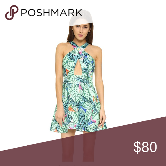 e9272af471c Leaf Linen Cross Over Dress Bright flowers peek from the lush leaf print on  this lively