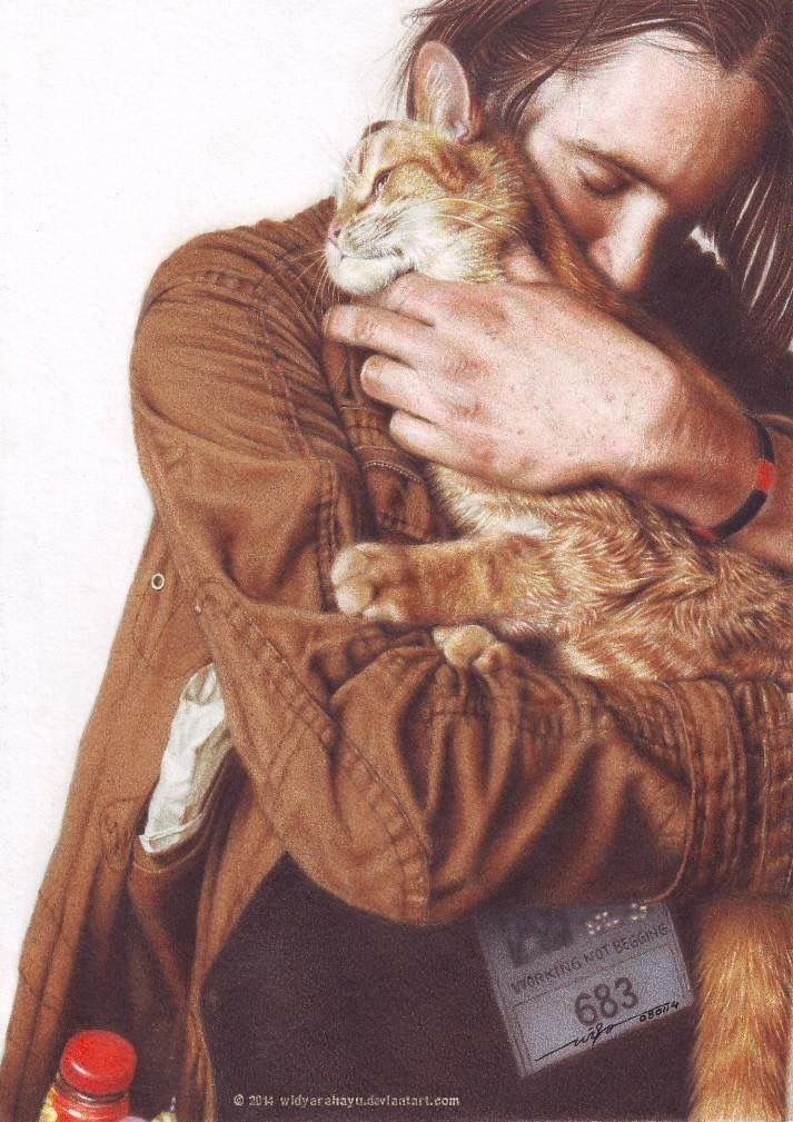 Probably my favorite pic of James and Bob! A cat named
