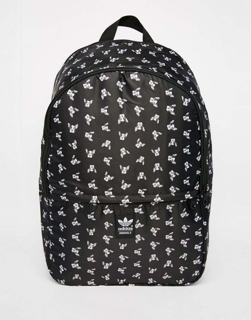 f0883a48833 Adidas | adidas Originals Rita Ora Puppy Print Backpack at ASOS ...