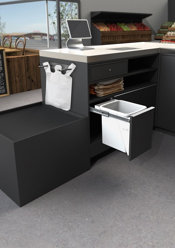 A 15L Hideaway Bin featured at a super market check out. | Hideaway ...