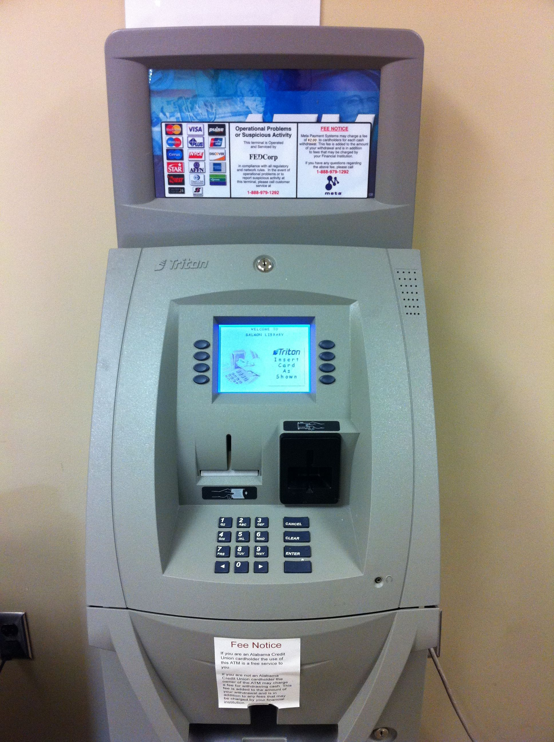 The benefits of having an ATM machine: A business owner sets and ...