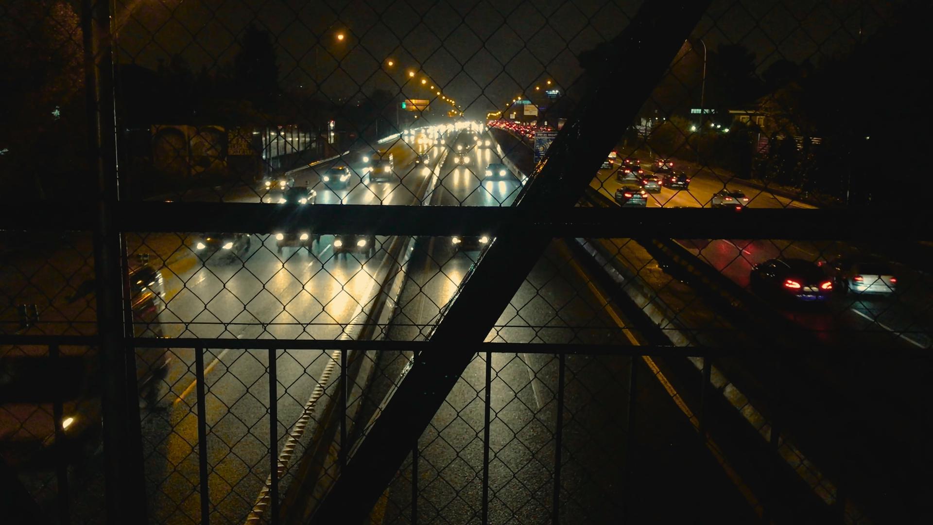 Traffic At Night From A Pedestrian Bridge.