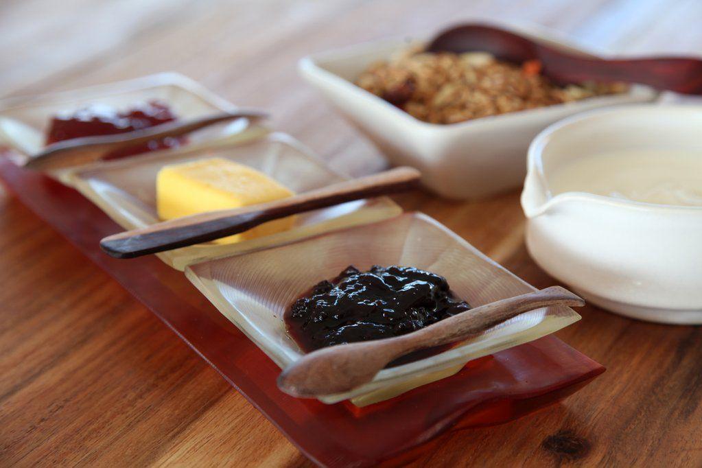 Breakfast buffet: fruit, yogurt,granola,cereals, fresh orange juice, bread, eggs, oats, waffles and coffee & tea.